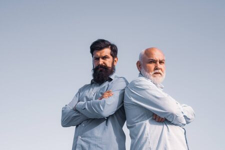 Elderly Senior man and bearded son - two generation concept. Man in different ages. Elderly pensioner and hipster son. Aged father. Family tradition.