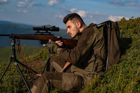 Illegal Hunting Poacher in the Forest. Hunter with shotgun gun after a hunt. Hunting in Russia.