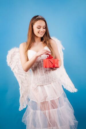 Concept of innocent girl. Love card. Valentines day. Cupid cute angel - Concept of Valentines Day. Love concept. Fashion Glamour Halloween art design. Enjoying magic moment.