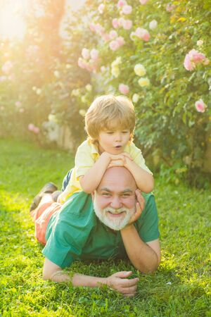 Men generation. Generation of people and stages of growing up. Grandpa retiree. Healthcare family lifestyle. Grandfather with son in park.
