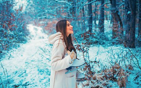 Images for winter. Winter woman clothes. Season of Winter. Models having fun in winter park.