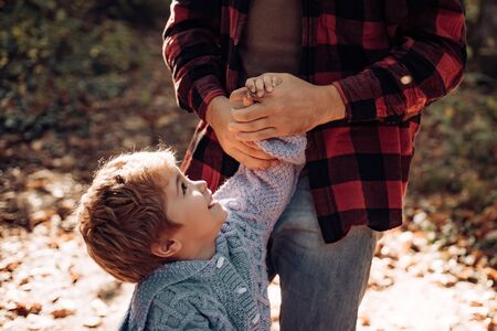 Parental support. Help kid explore world. Dad hold hand of little boy. Manly father upbringing little child. Trust and support. Feeling support from parent. My father is my world. True support