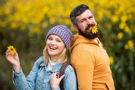 Fashion autumn portrait woman and man with yellow maple leaves on nature background. Autumn and leaf fall Dreams. Hello Autumn. Autumn love story - portrait couple in love. 写真素材