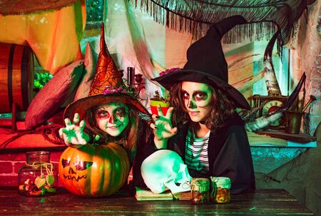 Children friends with pumpkin dressed like vampire for Halloween party. Happy Halloween with sweets candles. Stock fotó