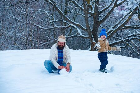Happy father and son play on winter Christmas time.