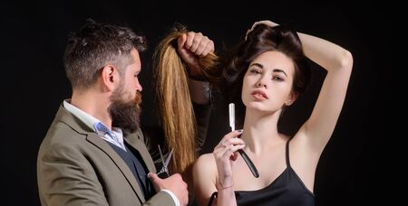 Barber - Shaves and Trims. Beard care. Bearded man getting haircut by hairdresser and sitting in chair at barbershop. Barber scissors and straight razor. Stok Fotoğraf