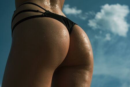 Buttocks ass close-up. Sexy girl with big bum. Sexy buttocks. Sexy butt. Perfect woman in a sexy lingerie. Фото со стока