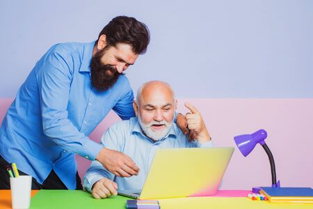 Businessman enjoying good news in Internet. Generation of people and stages of growing up. Two businessmen working at workplace.