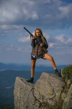 Hunter girl with his rifle. Nature places for hunting. Hunting in spring forest. Wildlife Hunting. American hunting rifles.
