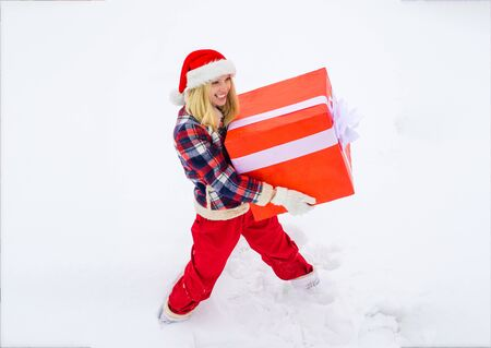 Winter fun activities. Winter emotion. Funny girl push big gift box full length concept. Winter delivery service. Woman present red gift box with ribbon bow isolated over white background