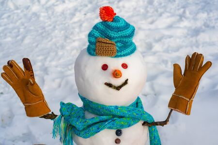 Snowman in snow forest. Merry Christmas and Happy Holidays. Snow men. Funny snowmen. Making snowman and winter fun. Christmas snowman close up with scarf