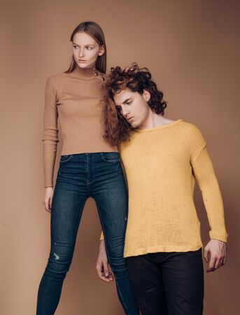 Jealousy of partners. Portrait of a good-looking male and female, standing twogether. self-confident young woman and serious dissatisfied man with stylish hairstyle. Attractive couple together. The beginning of life of a young couple. Family laws and rules. Stockfoto