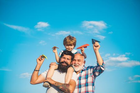 Family generation: future dream and people concept. Boy with father and grandfather. Generations men. Dream of flying. Stock Photo