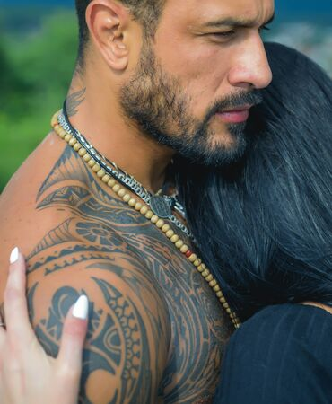 Sexy and fit woman and hugging handsome man with tattoo. Passion and sensual touch. Young couple in love hug each other. Romantic and love. Archivio Fotografico - 132078012