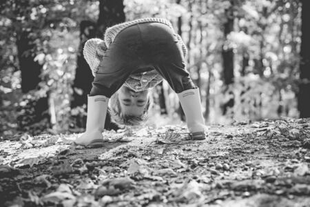 Happy childhood. Funny hello in in the autumn forest for a walk. Active child and comfortable child clothes concept. Funny childrens pose. Carefree childhood.