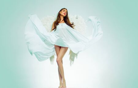 Happy Valentines Day. Valentines Day concept. Angel girl. Beautiful fairy flying girl in white dress. Angel woman with wings isolated.