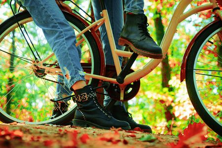 Autumn tree leaves and vinrage bike. Enjoying good autumn weather. Fall concept. Riding the bicycle in the park. Active people. Outdoors