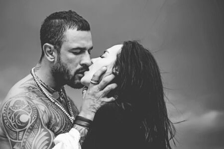 Passionate man gently kissing beautiful woman. Romantic couple kissing. Lover enjoys touching soft skin of sensual sexy lady. Passionate couple in love. Lovers having romantic moments.