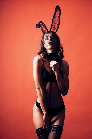 Happy Valentines Day. Brunette posing wearing bunny ears. Female with posing wearing bunny ears on Easter day. Cute bunny. Expression face.