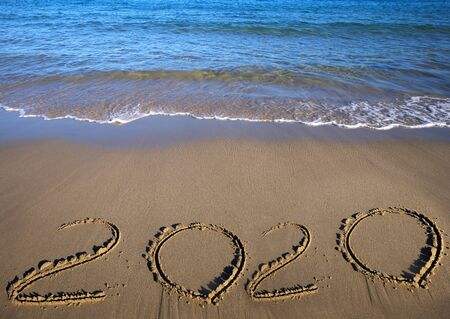 Sand beach drawing 2020. Happy New 2020 Year. Merry Christmas and Happy New Year. Background. Sea and sand beach. Copy space. Holidays. Background and textures concept