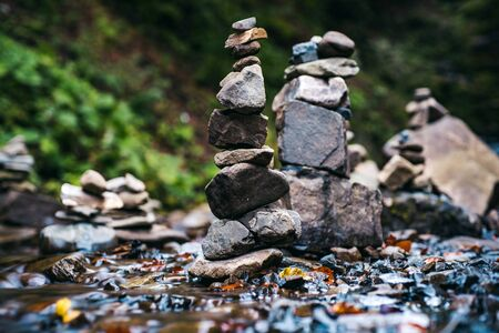Rock, petro, stone photography. Stony shore of river with waterfall. Autumnal season forest. Rocky turret and waterfall landscape. Copy space. Wallpaper background