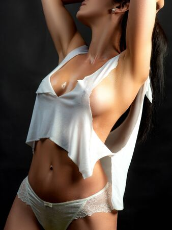 Beauty of womans body. Wet with water sensual young girl with slim fit figure and natural big bust. Attractive sexy woman wearing white underwear. Natural big boobs concept. 写真素材