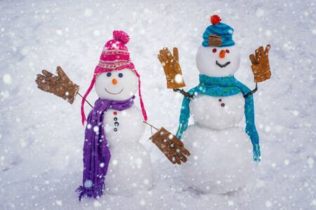 Winter snow decorating. Snowman couple enjoying intimacy. Funny Laughing Surprised snowman Portrait. Winter Love story. Funny snowmen. Happy winter time. Sensual touch. Stock Photo