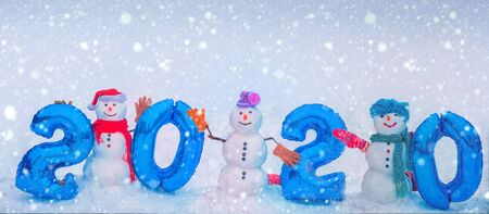 2020. Cute little snowmans and numerical symbols of Happy New 2020 year. Christmas Background and textures concept. Merry Christmas and Happy 2020 New Year.