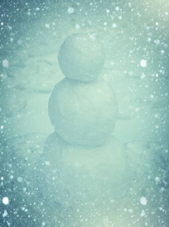 Snowman outdoor. Winter Art Greeting Card. Snowman standing in winter Christmas landscape 版權商用圖片