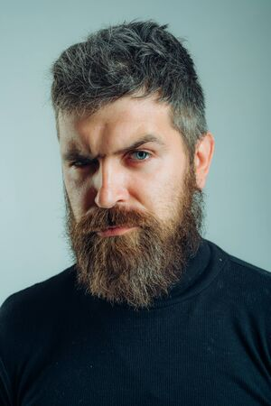Handsome bearded man. Brutal hipster boy. Confident concept. Urban lifestyle concept. Man with confident face and brutal style isolated. Barbershop advertising. Copy space. Foto de archivo