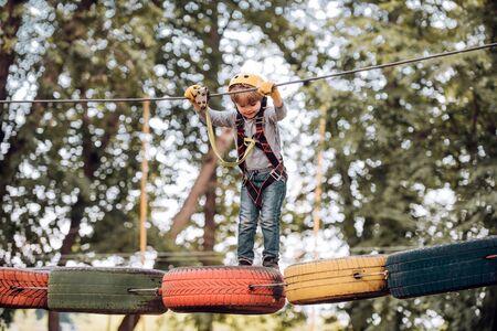 Early childhood development. Children fun. Go Ape Adventure. Children summer activities. Toddler age. Child concept. Adventure climbing high wire park.