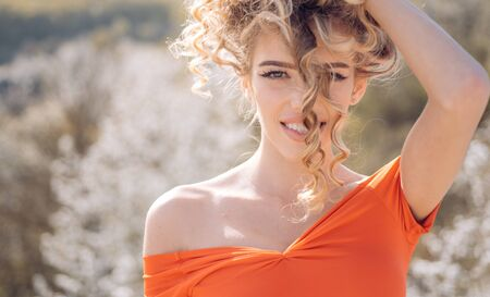 Beautiful woman. Sexy glamour girl with curly hair. Fashion model.