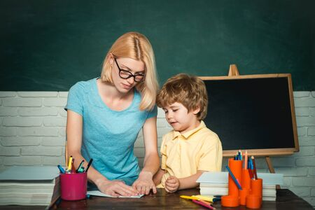 Teacher and kid. Great study achievement. Educational process. School and kid concept. Back to school and happy time. Teacher and child. Stockfoto