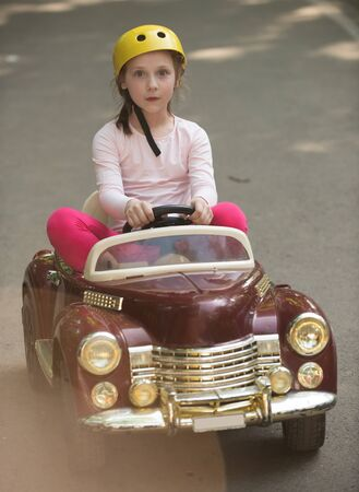 The baby is driving the car. Little woman enjoy life. Funny girl. Carefree child. Little child enjoy walk. Only fun is on my mind.