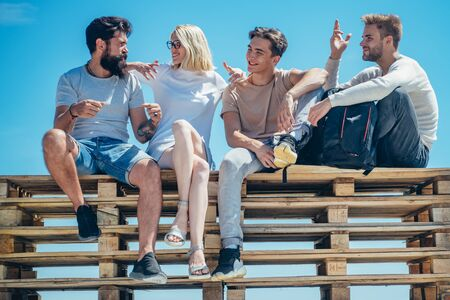 Best friends concept. Hipster style. Blue sky. Teammates gather together and have fun. Sweet memories about summer holidays. Teammates gather together and have fun.