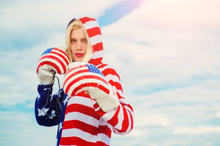 Woman american boxer with boxing glove. Freedom and 4th July patriotic concept.