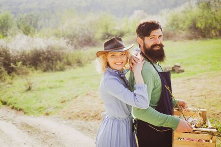 Eco living. Family of rural workers. Farming and agriculture cultivation. Lifestyle and family life. Couple Gardener. Portrait of wife and husband while working in garden. Country life.