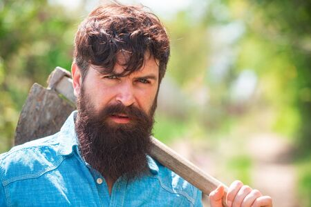 Portrait of bearded gardener. Father spend time in the farm. Planting concept. Farmer on farmland. Earth day.