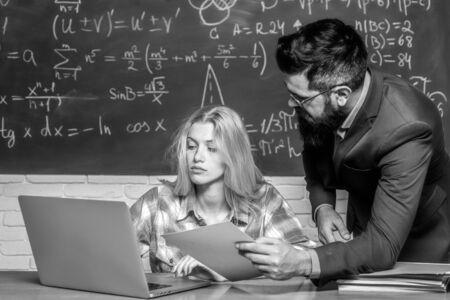 Teacher helping his students with math or mathematics on education class. Back to school. Teacher teaches a student. Team collaboration concept. Teacher. Standard-Bild