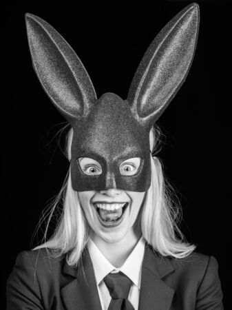 Fashion studio photo of beautiful girl with blond hair with bunny ears. Bunny woman. Easter bunny woman. Easter dinner menu. Blonde woman in rabbit bunny ears.