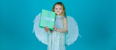 Valentines Day. Angel child from heaven gives you gift. Lovely and cute little Girl angel. Portrait of beautiful angel little girl with angels wings.