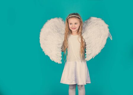 Valentines Day. Angel kid with blonde curly hair. Happy little Angel. Lovely and cute little Girl angel. Angel kid with blonde curly hair. Фото со стока