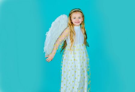 Happy little Angel. Angel child. Cute child girl posing with angel wings. Child angel with a beautiful wings. Saint Valentines Day card. Reklamní fotografie