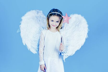 Pretty little angel girl. Valentines day. Christmas Cute little Angel. Cute toddler girl in white wings as Cupid.