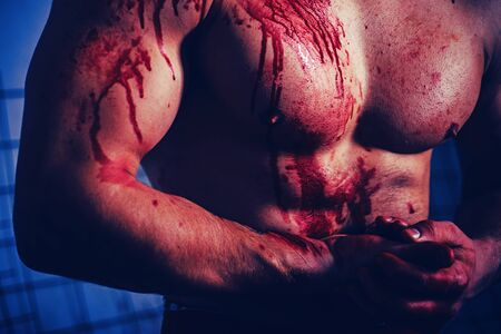 Mutant concept. Psycho mad man. Murderer brutal aggressive guy. Aggressive person. Injured soldier. Chest muscular torso with bloody streams. Pain and gain. Pain and injury. Body soiled blood.