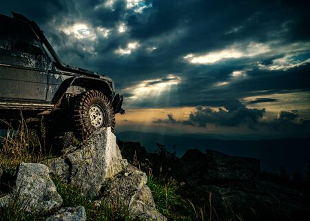 Extreme off road tour in a forest. Truck car wheel on offroad steppe adventure trail. Off road four wheel expedition to the villages on mountain road.