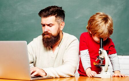 Back to school. School children. Elementary school. Concept of education and teaching. Happy family. Teacher helping young boy with lesson. Tutoring. Stockfoto