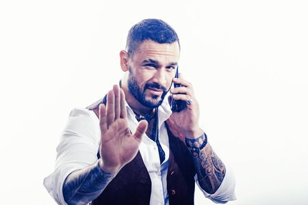 Business call. Man well groomed rich fashionable macho. Clothes and accessories. Fashion macho. Mobile conversation. Bearded guy white background. Mafia boss. Guy handsome mafia boss hold smartphone Stock fotó