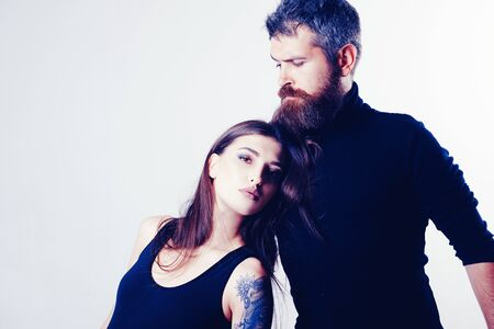 couple in love. brutal bearded man and woman with tattoo. hairdresser and barbershop. tattoo salon. male beard care. hipster man with sexy girl. relationship. fashion couple. copy space Banque d'images