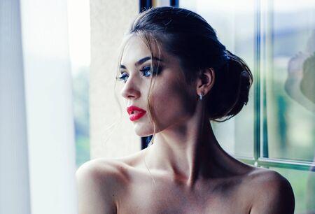 Bathrobe woman. Elegant beautiful woman. Beautiful sexy young woman. Fashion photo. Banque d'images